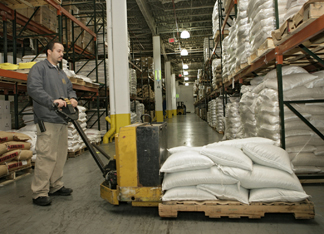 View of a worker moving goods on a pallet.